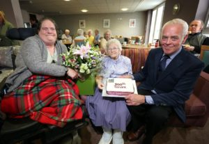 Claire Rabbetts and Bill Midgley celebrate with our 500th tenant, Joan Toward